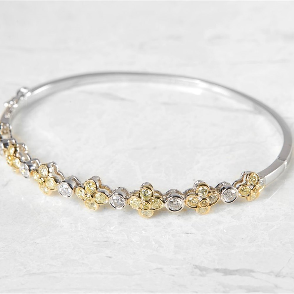 18k White Gold, total weight - 12.29 grams 18k White Gold Fancy Yellow Diamond Floral Bangle